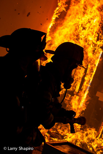 Woodstock Fire Rescue District training fire firefighters silhouette
