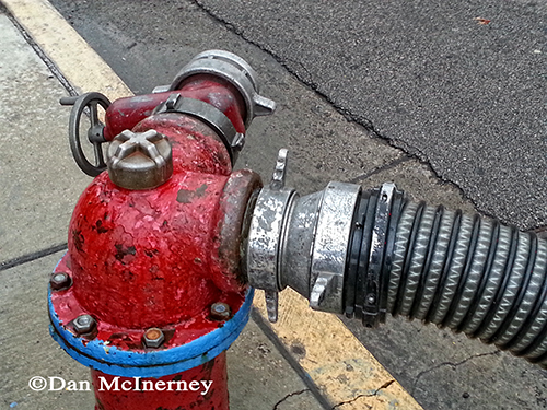 fire hydrant being used during a fire
