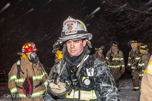 fire chief covered with ice