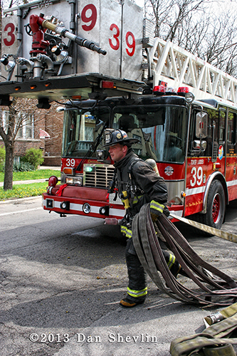 fireman with lots of hose