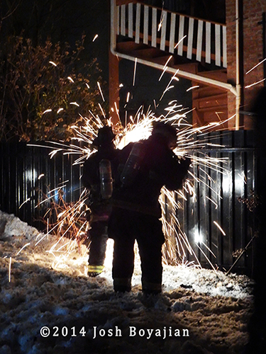 firemen cut steel fence at night