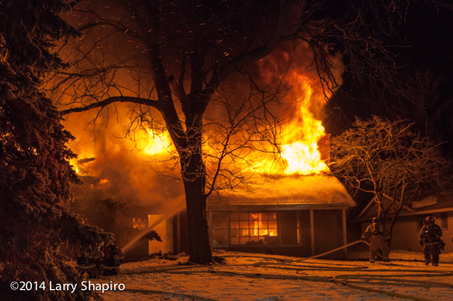 house fully engulfed in fire at night