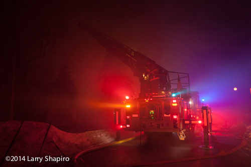 fire truck at night surrounded by smoke