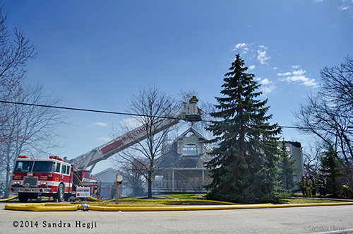 tower ladder with house destroyed by fire