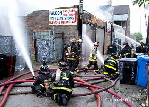 firemen use multi-versal units at fire scene