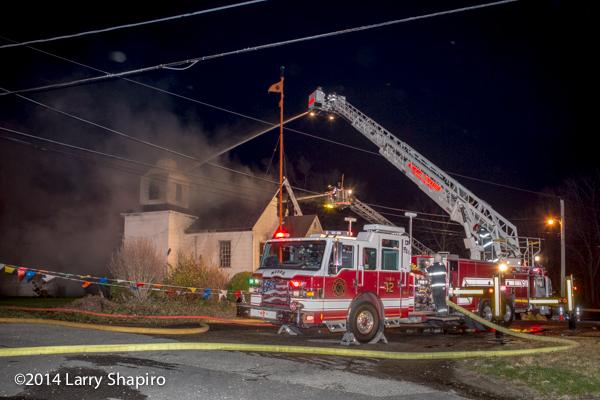 McHenry TWP FD Pierce Velocity tower ladder at night fire scene