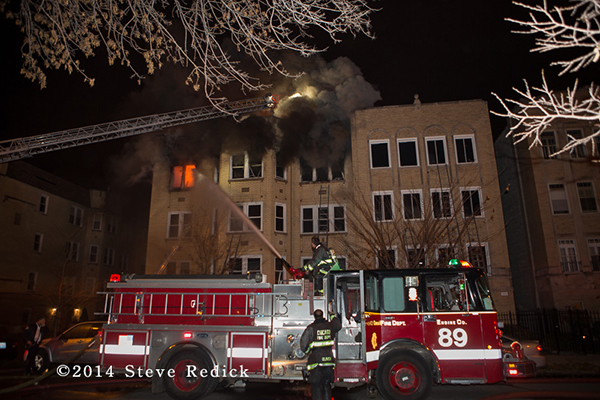 Chicago FD Engine 89 working at a night fire scene