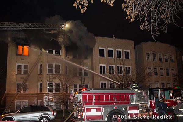 fireman with deck gun at fire scene