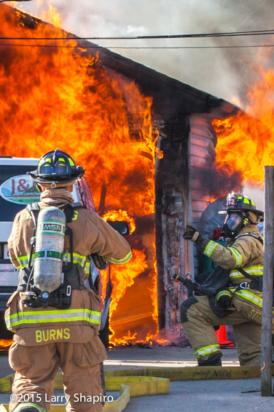 fireman gets ready to fight fully engulfed garage fire