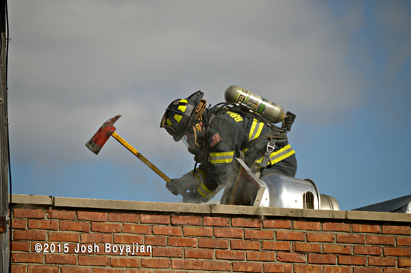 fireman on roof at commercial fire