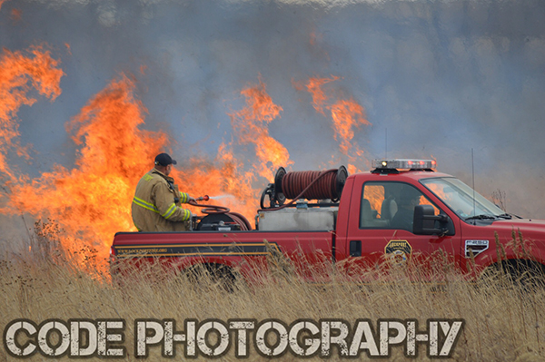 Lockport firefighters fight a brush fire