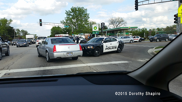 Dodge Charge police car at car crash