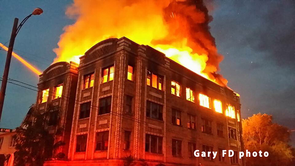 vacant 4-story building fully engulfed in fire