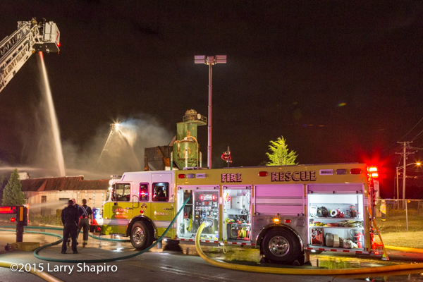 Spartan fire engine flowing at night fire scene