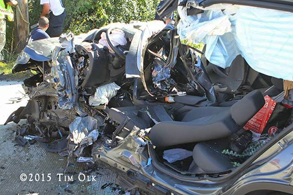 car after being cut apart by firefighters