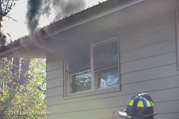 smoke from window at house fire