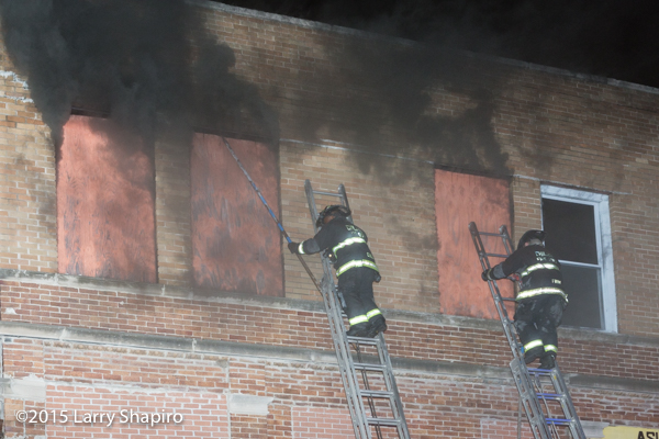 fireman on ladder with heavy smoke