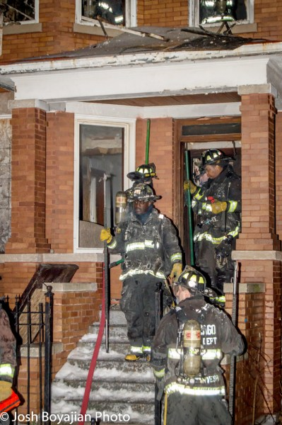 Chicago firefighters leave vacant building after a fire