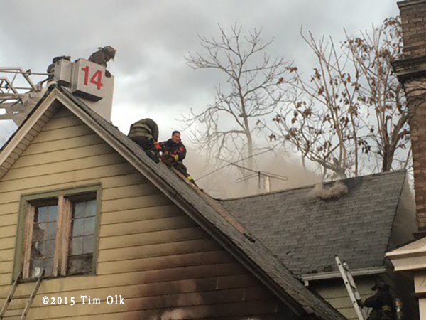 firefighters vent peaked house roof