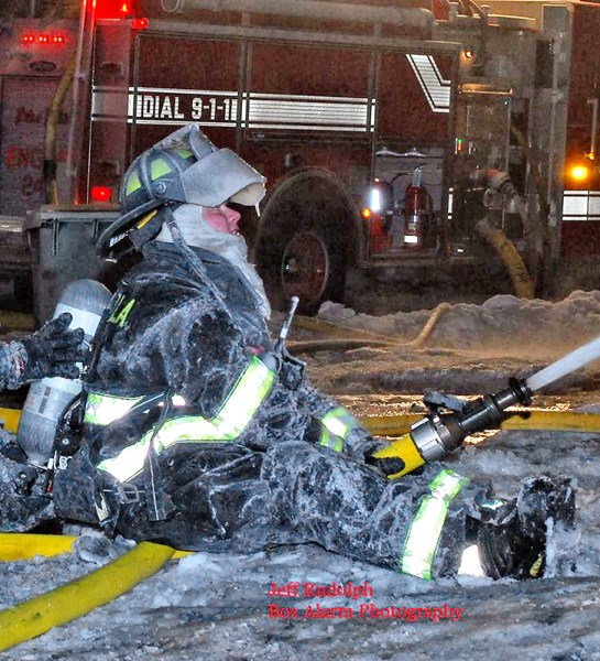 female firefighter coated with ice at fire scene