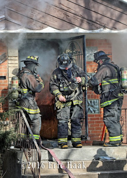 firefighters make entry to house fire
