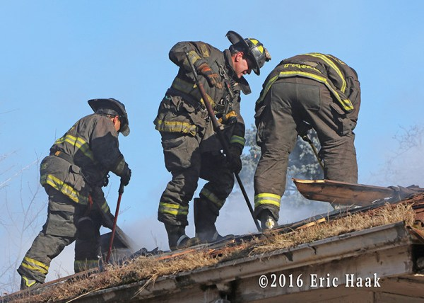 Chicago firefighters vent roof at house fire
