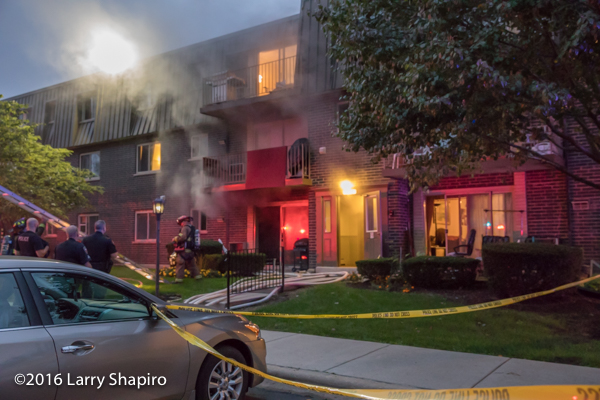 smoke from three-story apartment building