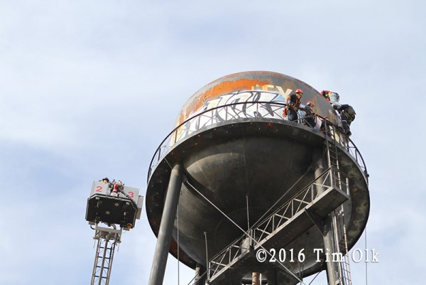 firefighters rescue worker from water tower