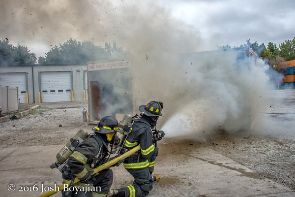 firefighters demonstrate firefighting