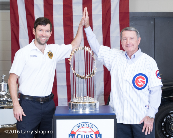 Firefighter and his father with the the World Series championship trophy