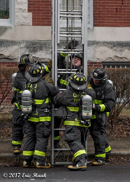 firefighters raise big ground ladder