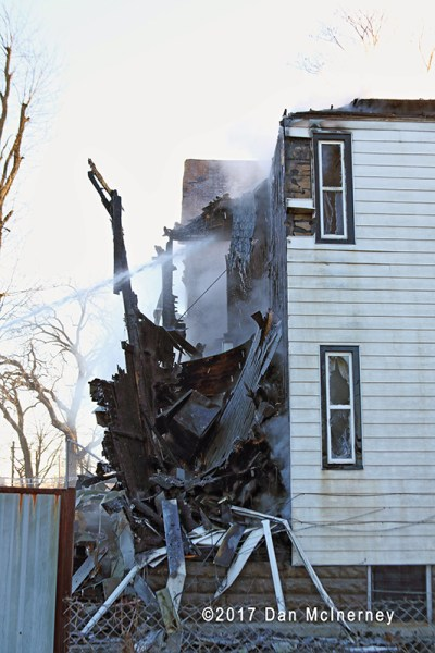 aftermath of house fire with collapse