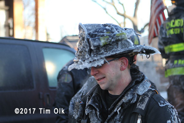 firefighter covered with ice after fire