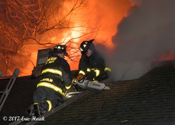 Chicago Firefighters on roof with flames