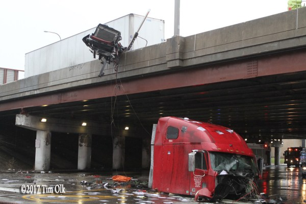 semi chassis dangling over a street where the cab separated