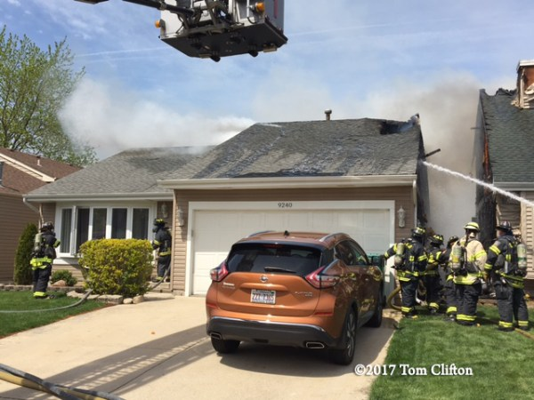 Firefighters battle house fire