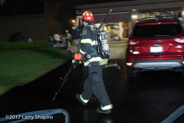 Firefighter with PPE and hand tools