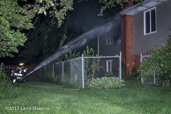 FF with hose line at house fire