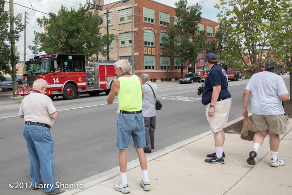 fire buffs photographing a fire engine