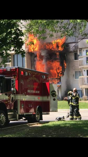 flames burn through apartments