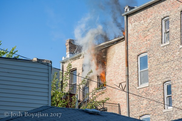 smoke and flames from 2nd floor window