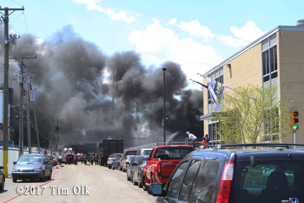 heavy black smoke from junkyard fire