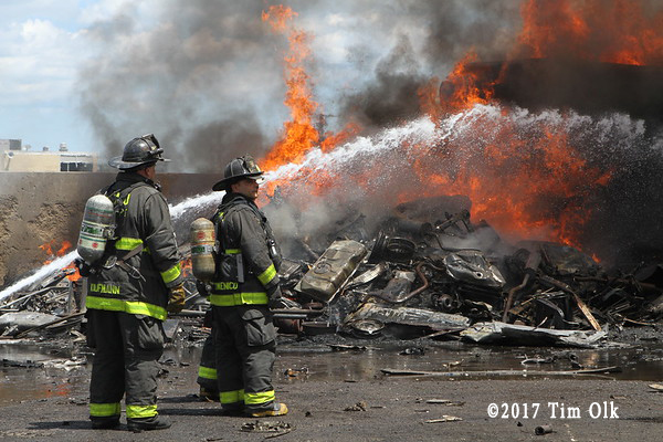 firefighters battle junk yard fire