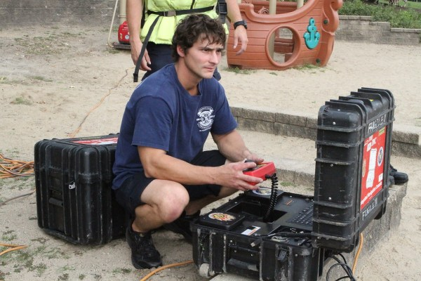 firefighter monitors sonar at dive recovery