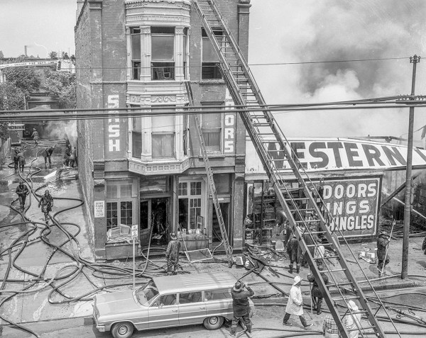 historic fire scene photo in Chicago with wooden aerial ladder