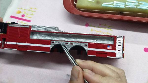 assembling a scale model of a Chicago fire truck
