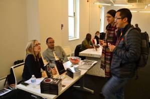Author exhibitor Lisa Lilly talks to attendees.