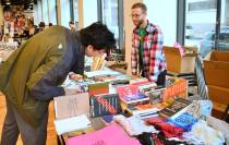 Patron browsing at Open Books table.