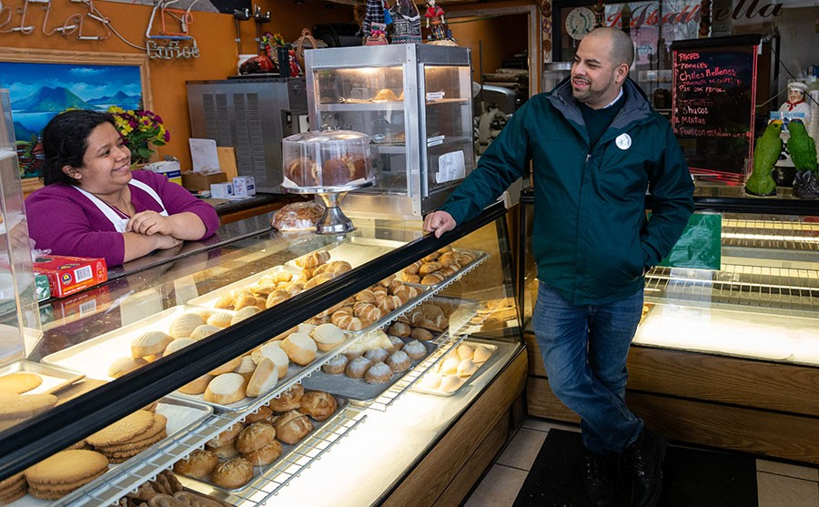 Andre Vasquez talks politics with a potential constituent at Isabella Bakery (1659 W. Foster) in January.