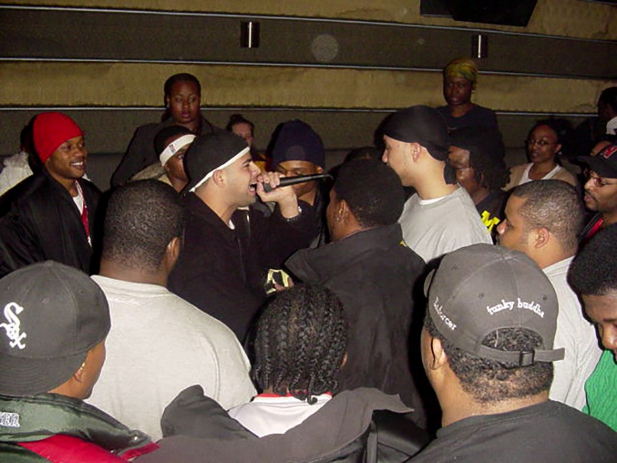 Vasquez on the mike at a rap battle in 2003